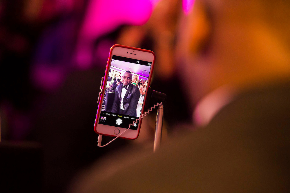 Al Bangura, former Watford FC player and Sport for Freedom Ambassador, takes a selfie - UK charity, Sport for Freedom (SFF), marks Anti-Slavery Day 2015 by hosting a charity Gala Dinner, supported by Aston Martin, on Thursday 15th October at Stamford Bridge, home of Chelsea Football Club. This inaugural event brought together people from the world of sport, entertainment, media, and business to unite behind a promise to tackle the issue of modern day human trafficking and slavery.  <br /> Hosted by Sky presenters Sarah-Jane Mee and Jim White, the Sport for Freedom Gala Dinner includes guests such as jockey AP McCoy OBE; Denise Lewis, former British Olympic Gold Medal winner; BBC Strictly star, Brendan Cole; Al Bangura, former Watford FC player and Sport for Freedom Ambassador who was trafficked from Africa to the UK at the age of just 14yrs old; Made in Chelsea star, Ollie Proudlock; ITV weather presenter, Lucy Verasamy; Sky Sports F1 presenter and SFF Ambassador, Natalie Pinkham; Premier League footballers Ryan Bertrand of Southampton FC and Troy Deeney of Watford FC and champion boxer, Anthony Joshua; and The UK's first independent Anti Slavery Commissioner, Kevin Hyland OBE, who highlighted the issues of modern day slavery that face the UK and world today. <br /> The evening concluded with chart topping music from 'Naughty Boy'. <br /> Sport for Freedom are also joining forces with the Premier League Academies for an international  'Football for Freedom' tournament with their U16's players that will also involve educating those taking part about the issues surrounding modern day slavery. The final will take place at Liverpool FC's Academy on Anti-Slavery Day, 18th October.