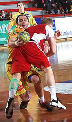 Alem Toskic vs Miha Zvizej at 15th round of Slovenian Handball MIK 1st league match between RD Slovan and RK Celje Pivovarna Lasko, on February 6, 2009, in Kodeljevo, Ljubljana, Slovenia. Win of RK Slovan 18:17. (Photo by Vid Ponikvar / Sportida)