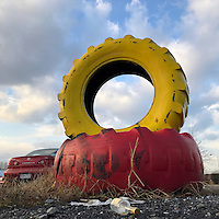 Painted tires mark an entrance to a gas station in Allentown, PA December 7, 2016.