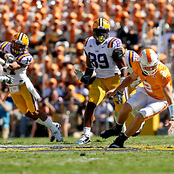 Oct 2, 2010; Baton Rouge, LA, USA; Tennessee Volunteers quarterback Matt Simms (2) scrambles for the ball after the ball was snapped over his head during the first half against the LSU Tigers at Tiger Stadium.  Mandatory Credit: Derick E. Hingle