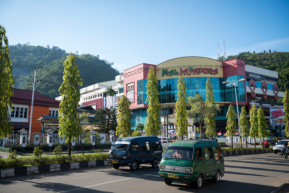 Jayapura, Papua, Indonesia - July 15, 2017: Traffic passes by Jayapura Mall, a prominent shopping center in Jayapura, the provincial capital of Papua, Indonesia.