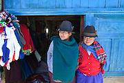 Two women outside a clothing shop on market day in Simiatug, Ecuador. (Supporting image from the project Hungry Planet: What the World Eats.).