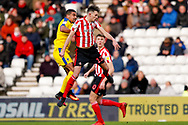 Wimbledon forward Kwesi Appiah (9) challenges with Sunderland defender Tom Flanagan (12)  during the EFL Sky Bet League 1 match between Sunderland and AFC Wimbledon at the Stadium Of Light, Sunderland, England on 2 February 2019.