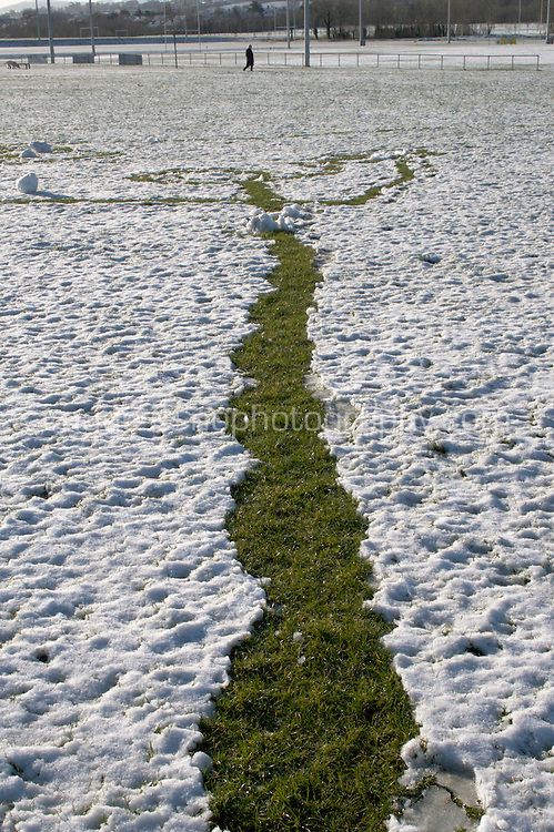 Track in the snow from snowman building in suburban Dublin Ireland