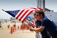 Firefighters take a break on the Asbury Park boardwalk during July Fourth weekend.