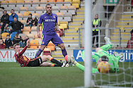 Josh Magennis (Charlton Athletic) watches as the ball beats Colin Doyle (Bradford City), hits the inside of the post and rebounds across the face of the goal, the ball then been cleared during the EFL Sky Bet League 1 match between Bradford City and Charlton Athletic at the Coral Windows Stadium, Bradford, England on 10 December 2016. Photo by Mark P Doherty.
