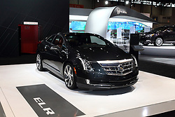 12 February 2015:  2015 CADILLAC ELR: The 107th annual Chicago Auto Show, Feb. 14-22, 2015, becomes the third year that the sleek Cadillac ELR electric vehicle luxury coupe has been displayed in the Windy City. It's the first application of an extended-range electric vehicle technology by a full-line luxury automotive brand. The Cadillac ELR has an aggressive, forward-leaning profile that introduces a new, progressive theme and proportion in Cadillac's design evolution. The overall shape is reinforced by a prominent, sweeping body line accented by 20-inch wheels pushed to the edges of the body. Making the ELR a standout are the light-emitting diode (LED) headlamps, daytime running lamps and taillamps, as well as signature front and rear lighting elements. Inside, the ELR's classic 2+2 layout is driver focused and fitted with leather-trimmed cockpit that blends authentic chrome and wood accents – and available carbon fiber trim – as well as a sueded microfiber headliner and steering wheel covered in leather and sueded microfiber. True engineering marvels power the ELR, combining pure electric drive and an efficient, range-extending 1.4L gasoline-powered electric generator capable of 207 horsepower of total system power. Using only the energy stored in the battery, the ELR delivers a range of about 35 miles of pure electric driving. The premium Bose 10-channel audio system with active noise cancellation is standard equipment.  For the record, the ELR design is almost unchanged from the Converj concept that was a hit at the '09 Chicago show.<br /> <br /> First staged in 1901, the Chicago Auto Show is the largest auto show in North America and has been held more times than any other auto exposition on the continent. The 2015 show marks the 107th edition of the Chicago Auto Show. It has been  presented by the Chicago Automobile Trade Association (CATA) since 1935.  It is held at McCormick Place, Chicago Illinois