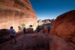 Hikers near Landscape Arch at Devils Garden, Arches National Park, Utah, US