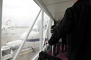 passengers on ramp before entering airplane