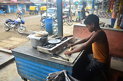 June 12, 2017 - Dimapur, India - Eleven year-old Indian boy, Raju baked Roti (bread) at a roadside hotel on World Day Against Child Labour in Dimapur, India northeastern state of Nagaland on Monday, June 12, 2017. The World Day Against Child Labour, first observed in 2002 and sanctioned by the International Labour Organization (ILO), aims to highlight the plight of children engaged in work that deprives them of adequate education, health, leisure and basic freedoms, violating their rights. Photo by Caisii Mao  (Credit Image: © Caisii Mao/NurPhoto via ZUMA Press)