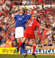 Photo. Glyn Thomas,  Digitalsport<br />Middlesbrough v Everton. Barclaycard Premiership.<br />Riverside Stadium, Middlesbrough. 21/09/2003.<br />Boro's Colin Cooper (R) is forced out of the way by Alan Stubbs.