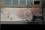 """ZHUZHOU, CHINA -  China Out - Finland Out<br /> <br /> Fake Brand Signs<br /> <br />  A fake """"Omega"""" brand sign hangs on a shop, which is under construction, on January 14, 2014 in Zhuzhou, Hunan Province of China. The developer said that in order to attract public attention and get better promotional effect, they made some slight alterations on these signs.©Exclusivepix"""