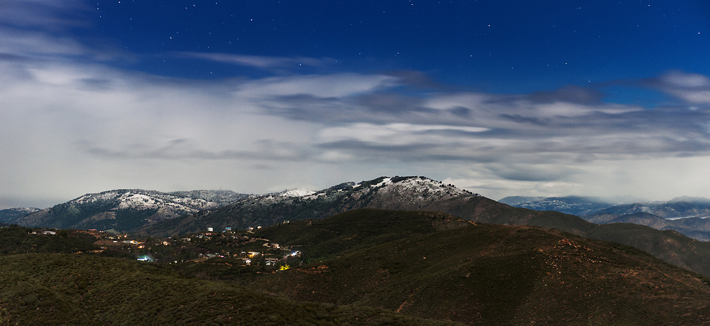 The town of Julian is seen on a moonlit night from an overlook along the sunrise highway in the laguna mountains.