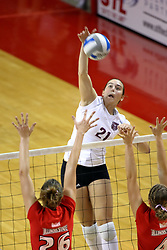 22 September 2007: Jamie Adams attacks  the ball towards Kari Staehlin and Erin Lindsey. In a nip and tuck match, the Missouri State Bears beat the Illinois State Redbirds 3 games to one at Redbird Arena on the campus of Illinois State University in Normal Illinois.