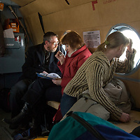 Passengers aboard a Russian helicopter peer out at the tundra as they fly to Arkhangel'sk from a remote arctic village.