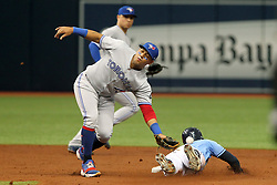 May 6, 2018 - St. Petersburg, FL, U.S. - ST. PETERSBURG, FL - MAY 06: Yangervis Solarte (26) of  the Blue Jays closes his eyes and pulls away after missing the thrown ball as Mallex Smith (0) of the Rays slides safely into second base during the MLB regular season game between the Toronto Blue Jays and the Tampa Bay Rays on May 06, 2018, at Tropicana Field in St. Petersburg, FL. (Photo by Cliff Welch/Icon Sportswire) (Credit Image: © Cliff Welch/Icon SMI via ZUMA Press)