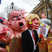 Put It To The People march for a Peoples Vote on 23rd March 2019 in London, United Kingdom. With less than one week until the UK is supposed to be leaving the European Union, the final result still hangs in the balance. An estimated one million protesters gathered to make political leaders take notice and to give the British public a vote on the final Brexit deal. A man dressed as the devil in front of a giant puppet of Michael Gove.