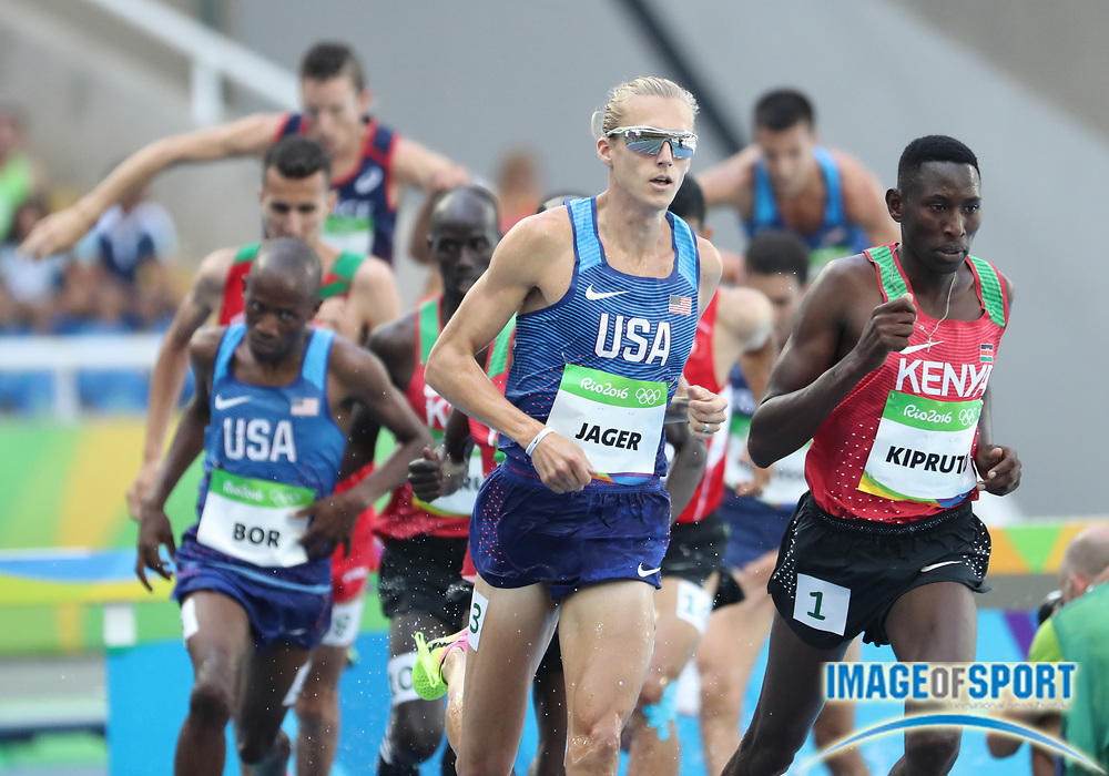 Aug 17, 2016; Rio de Janeiro, Brazil; Conseslus Kipruto (KEN)  and Evan Jager (USA) race during the men's 3000m steeplechase final in the Rio 2016 Summer Olympic Games at Estadio Olimpico Joao Havelange. Mandatory Credit: Kevin Jairaj-USA TODAY Sports