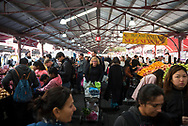 Melbourne, Australia - August 20, 2017: People shop on a Sunday afternoon at Queen Victoria Market in Melbourne, Australia.