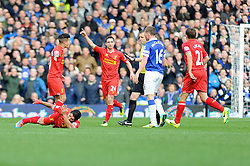 Liverpool's Luis Suarez goes down injured after a challenge by Everton's Kevin Mirallas - Photo mandatory by-line: Dougie Allward/JMP - Tel: Mobile: 07966 386802 23/11/2013 - SPORT - Football - Liverpool - Merseyside derby - Goodison Park - Everton v Liverpool - Barclays Premier League