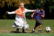 Kevin Bartram   Staff<br /> Iaesha Wali and her brother Abo-Baker Wali play soccer at Stanley Quarter Park on Tuesday. Their family moved from Iraq three years ago and now lives in New Britain.