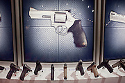 15 MAY 2009 -- PHOENIX, AZ: Handguns on display in the Taurus booth Friday. More than 60,000 people are expected to attend the NRA convention and annual meeting, which is being held at the Phoenix Convention Center through Sunday. This is the 138th annual meeting of the National Rifle Association. Photo by Jack Kurtz