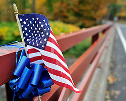 Supporters of the state police have tied blue bows and placed small American Flags on bridges throughout Barrett and Price Township. Police continue to search the heavily wooded terrain for fugitive Eric Matthew Frein on Oct. 3, 2014, near Canadensis, Pa. (Chris Post | lehighvalleylive.com)