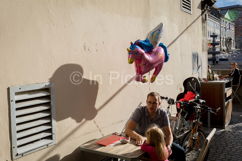 A childs balloon shadow on the wall of a cafe off Cankarjevo Nabrezje in the Slovenian capital, Ljubljana, on 25th June 2018, in Ljubljana, Slovenia.