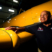 Harold Brown, a former Tuskegee Airmen pilot, poses for a portrait with the Harvard IV T6J at the Liberty Aviation Museum in Port Clinton, Ohio, on Monday, July 24, 2017. Brown flew a plane of a similar model as a trainer plane during his training. THE BLADE/KURT STEISS