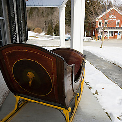 A sleigh with a portrait of George Washington on the porch of the Old Tavern in Grafton, Vermont.