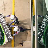Bentley crew memebers push the Bentley GT3R onto the pit lane at the Blancpain Endurance Series, Nurburgring