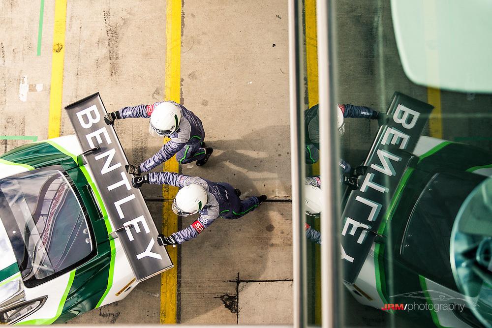 Bentley crew memebers push the Bentley GT3R onto the pit lane at the Blancpain Endurance Series, Nurburgring