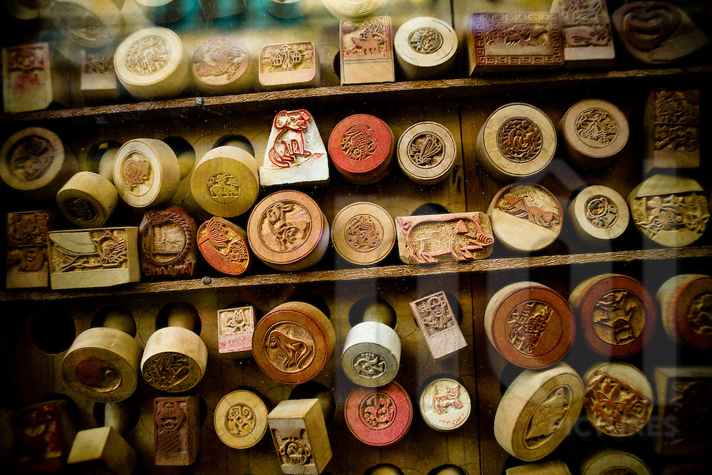 Chiseled wooden stamps lined up in a workshop of a craftsman, Hanoi, Vietnam, Southeast Asia