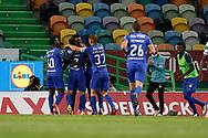 Mateo Cassierra celebrates with teammates during the Liga NOS match between Sporting Lisbon and Belenenses SAD at Estadio Jose Alvalade, Lisbon, Portugal on 21 April 2021.