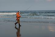 A fisherman on the town beach at Narragansett, Rhode Island.