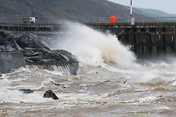 © Licensed to London News Pictures. 21/09/2018. Aberystwyth, UK.The gale force winds of Storm Bronagh, the second named storm of the UK winter, brings waves crashing against the harbour in Aberystwyth .Photo credit: Keith Morris/LNP