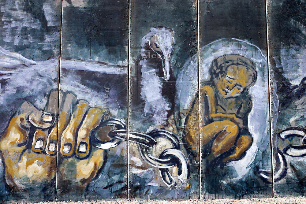 Drawings on the Palestinian side of the Israeli Separation Wall in Abu Dis, few minutes away from Jerusalem, on Wednesday, Nov. 9, 2005. **ITALY OUT**..