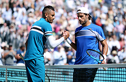 Nick Kyrgios (left) shakes hands with Feliciano Lopez after beating him during day five of the Fever-Tree Championship at the Queen's Club, London.