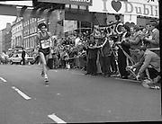 Finish of Dublin City Marathon .25/10/1982  Radio 2, Dublin City Marathon..1982.25.10.1982.10.25.1982.25th October 1982..The Radio 2 sponsored Dublin City Marathon finish at St Stephens Green Dublin..The overall winners were:Men, Gerry Kiernan,Listowel, Kerry. Women, Debbie Mueller,U.S.A. and the first wheelchair competitor Michael O'Rourke..Gerry Kiernan looking remarkably fresh crosses the finish line
