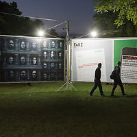 Visitors watch politics themed billboards on display at the Arc Billboard social issues exhibition in Budapest, Hungary on Sept. 24, 2018. ATTILA VOLGYI