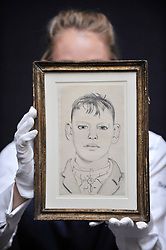 """© Licensed to London News Pictures. 06/10/2017. London, UK. A technician presents """"Boy on the Stairs"""", 1948, by Lucien Freud at a preview at Sotheby's in New Bond Street of contemporary, impressionist and modern art works to be auctioned in New York in November 2017 Photo credit : Stephen Chung/LNP"""