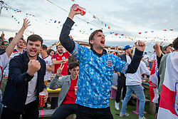 © Licensed to London News Pictures. 03/07/2021. London, UK. Football fans celebrate an England goal at the 'Skylight - Rooftop Bar' in London's Tobacco Dock during the England v Ukraine EURO 2020 Quarter Final match played at Stadio Olimpico in Rome. Photo credit: Peter Manning/LNP