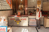 A temple keeper invited me in for a photo in Pune, Maharashtra, India