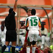 Senegal's Salif Diao is shown the red card for his challenge on Denmark's Rene Henriksen
