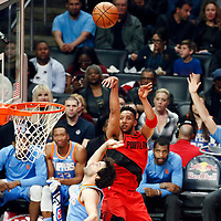 18 March 2018: Portland Trail Blazers forward Evan Turner (1) takes a jump shot over LA Clippers guard Milos Teodosic (4) during the Portland Trail Blazers 122109 victory over the LA Clippers, at the Staples Center, Los Angeles, California, USA.