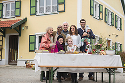 Big family and friends enjoying outdoor dining party at farmhouse, Bavaria, Germany