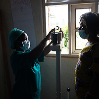 Beatrice Nicole Habari (left) is a nurse in Vighole near Butembo. Here she attends a patient in the Vighole clinic. Local health infrastructure was improved and the health teams in the area were supported and strengthened during the Ebola crisis which ended in June 2020.