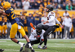 Nov 23, 2019; Morgantown, WV, USA; Oklahoma State Cowboys place kicker Matt Ammendola (49) kicks a field goal during the fourth quarter against the West Virginia Mountaineers at Mountaineer Field at Milan Puskar Stadium. Mandatory Credit: Ben Queen-USA TODAY Sports