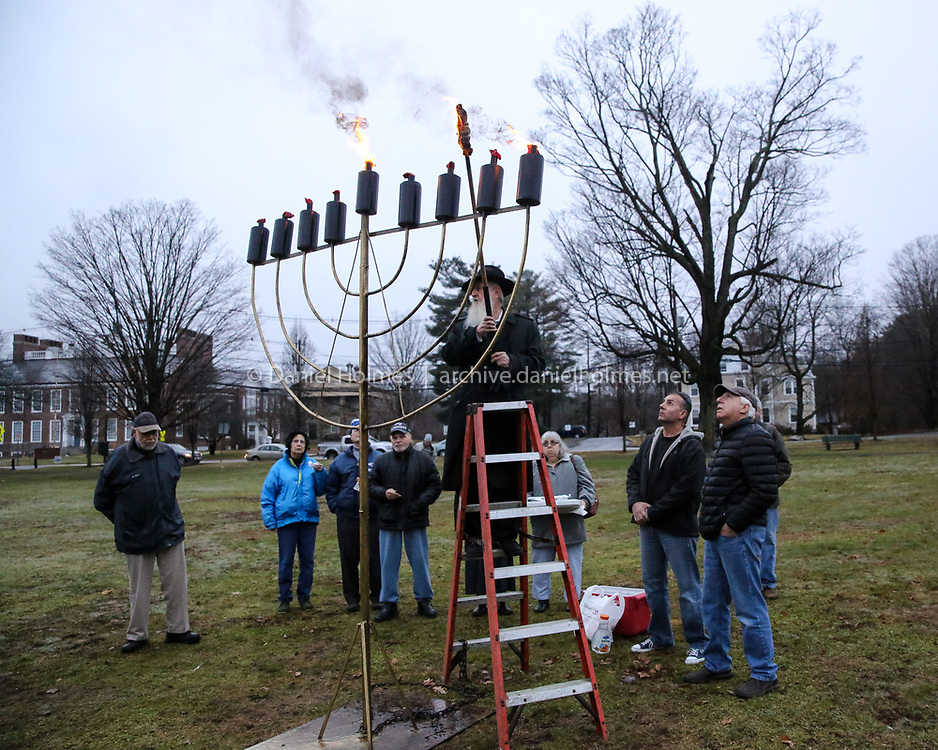 (12/2/18, FRAMINGHAM, MA) Rabbi Yakov Lazaros lights a giant menorah on Framingham Centre Common for the first day of Hanukkah on Sunday. [Daily News and Wicked Local Photo/Dan Holmes]