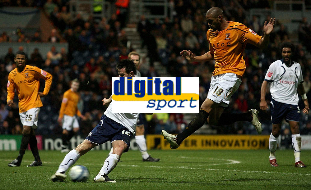 Photo: Paul Thomas/Sportsbeat Images.<br /> Preston North End v Hull City. Coca Cola Championship. 04/12/2007.<br /> <br /> Sean St Ledger (L) of Preston tries to pass away from Caleb Forlan (18).